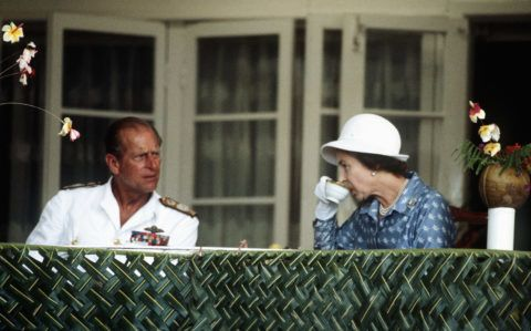 NAURU - OCTOBER 1:  Queen Elizabeth ll and Prince Philip,the Duke of Edinburgh enjoy a cup of tea in Nauru during their tour of the South Pacific islands in October, 1982. (Photo by Anwar Hussein/Getty Images)