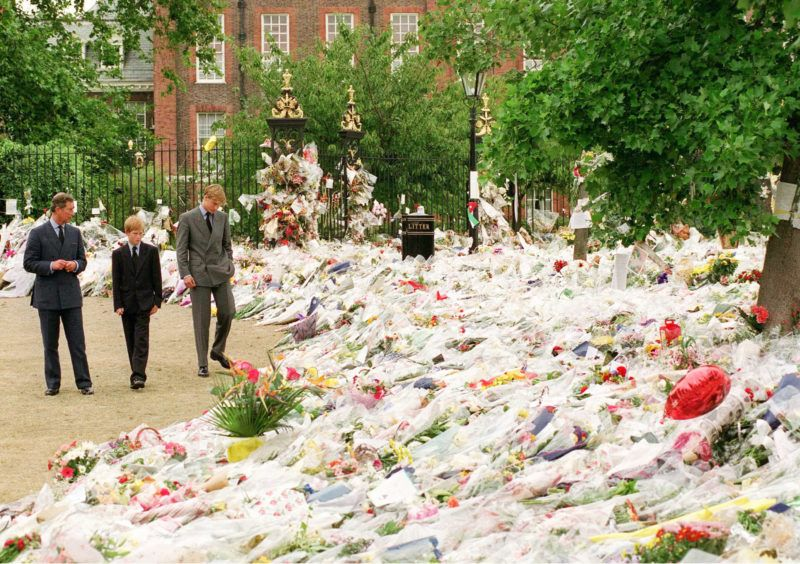 LONDON - SEPTEMBER 1997: Prince William, Prince of Wales, with his sons Princes William and Harry looking at floral tributes left at Kensington Palace following the death of Diana, Princess of Wales in September, 1997.  (Photo by Anwar Hussein/WireImage)