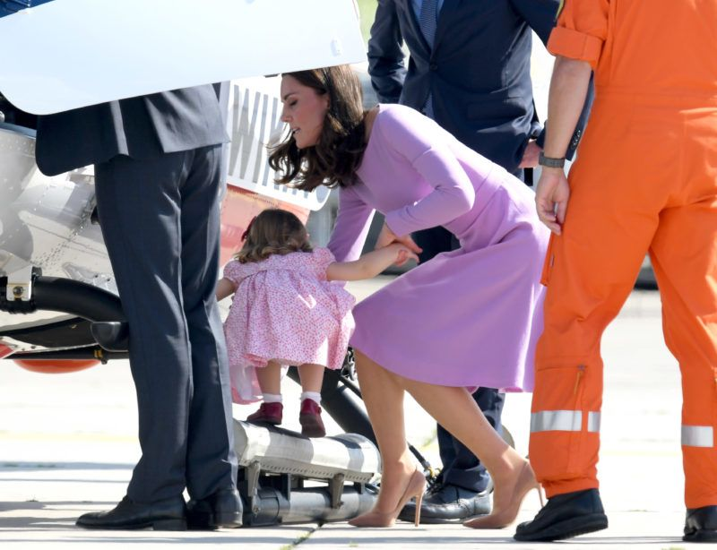 HAMBURG, GERMANY - JULY 21:  Princess Charlotte of Cambridge and Catherine, Duchess of Cambridge view helicopter models H145 and H135 before departing from Hamburg airport on the last day of their official visit to Poland and Germany on July 21, 2017 in Hamburg, Germany.  (Photo by Karwai Tang/WireImage)