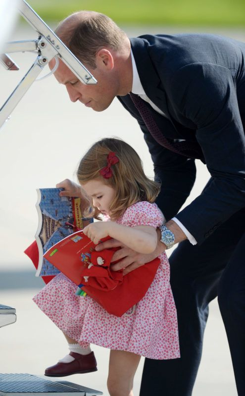 HAMBURG, GERMANY - JULY 21:  (NO UK SALES FOR 28 DAYS FROM CREATE DATE) Princess Charlotte of Cambridge and Prince William, Duke of Cambridge depart from Hamburg airport on the last day of their official visit to Poland and Germany on July 21, 2017 in Hamburg, Germany.  (Photo by Pool/Samir Hussein/WireImage)
