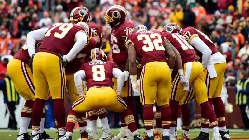 LANDOVER, MD - DECEMBER 24: The Washington Redskins huddle in the first half against the Denver Broncos at FedExField on December 24, 2017 in Landover, Maryland. (Photo by Patrick McDermott/Getty Images)