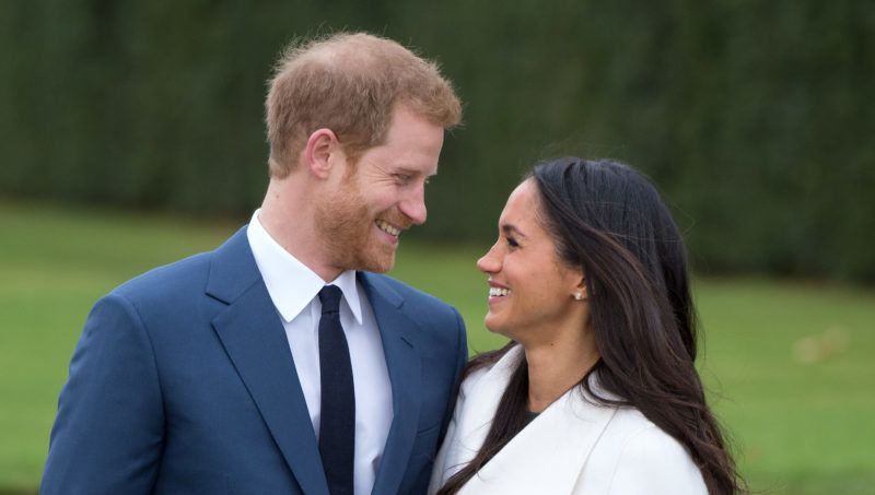 LONDON, ENGLAND - NOVEMBER 27:  Prince Harry and Meghan Markle, wearing a white belted coat by Canadian brand Line The Label, attend a photocall in the Sunken Gardens at Kensington Palace following the announcement of their engagement on November 27, 2017 in London,  England. (Photo by Anwar Hussein/Getty Images) *** Local Caption *** Prince Harry;Meghan Markle