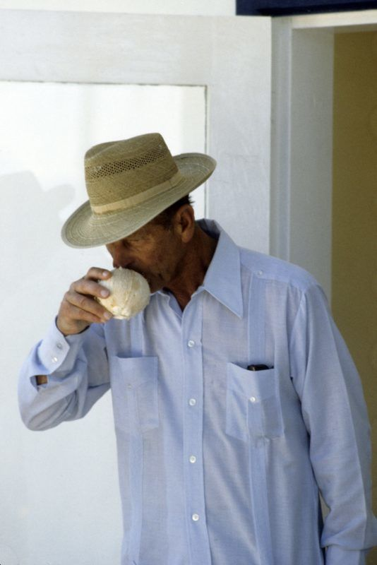 TUVALU - OCTOBER 27: Prince Philip, Duke of Edinburgh, wearing a straw hat, drinks from a coconut on October 27, 1982 in Tuvalu. (Photo by Anwar Hussein/Getty Images)