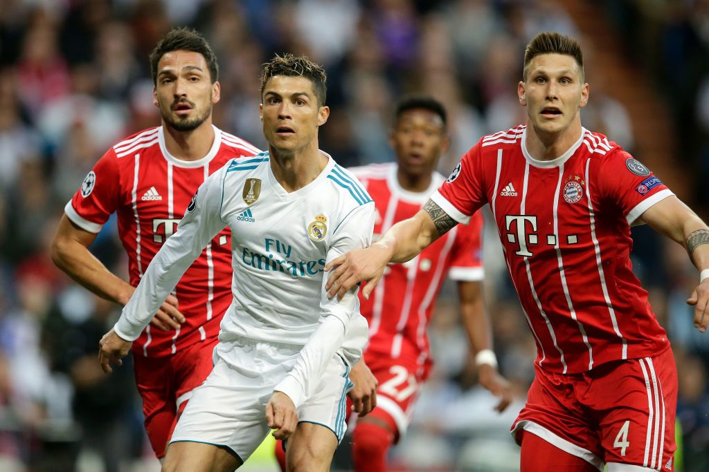 MADRID, SPAIN - MAY 1: (L-R) Cristiano Ronaldo of Real Madrid, Niklas Sule of Bayern Munchen  during the UEFA Champions League  match between Real Madrid v Bayern Munchen at the Santiago Bernabeu on May 1, 2018 in Madrid Spain (Photo by Eric Verhoeven/Soccrates/Getty Images)
