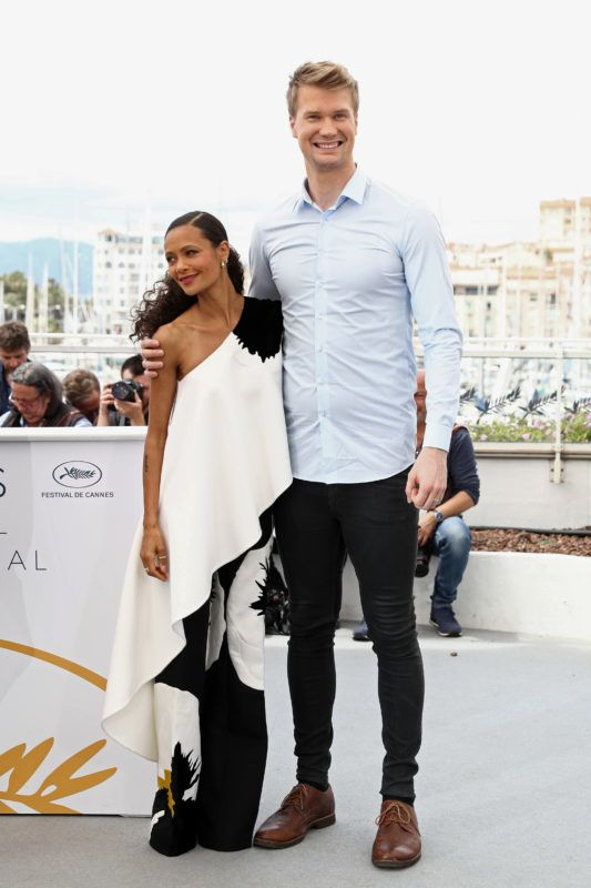 "CANNES, FRANCE - MAY 15:  Thandie Newton and Joonas Suotamo attend the photocall for ""Solo:  A Star Wars Story"" during the 71st annual Cannes Film Festival at Palais des Festivals on May 15, 2018 in Cannes, France.  (Photo by Tristan Fewings/Getty Images)"