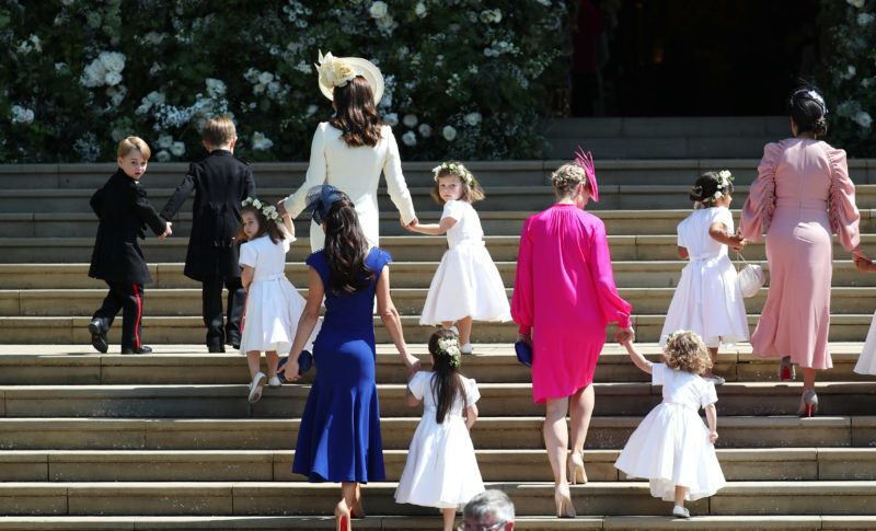 WINDSOR, UNITED KINGDOM - MAY 19:  Catherine, Duchess of Cambridge arrives with the bridesmaids and page boys at St George's Chapel at Windsor Castle for the wedding of Prince Harry and Meghan Markle in St George's Chapel at Windsor Castle on May 19, 2018 in Windsor, England. (Photo by DJane Barlow - WPA Pool/Getty Images)