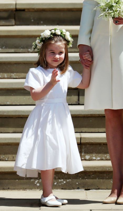 WINDSOR, UNITED KINGDOM - MAY 19:  Princess Charlotte on the steps of St George's Chapel after the wedding of Prince Harry and Meghan Markle in St George's Chapel at Windsor Castle on May 19, 2018 in Windsor, England. (Photo by Jane Barlow - WPA Pool/Getty Images)