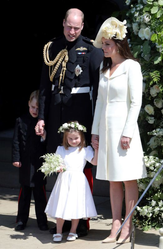 WINDSOR, UNITED KINGDOM - MAY 19:  Prince William, Duke of Cambridge and Catherine, Duchess of Cambridge with Prince George and Princess Charlotte leave St George's Chapel, Windsor Castle after the wedding of Prince Harry, Duke of Sussex and the Duchess of Sussex on May 19, 2018 in Windsor, England. (Photo by Andrew Matthews - WPA Pool/Getty Images)