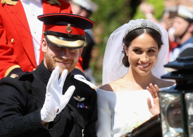 WINDSOR, ENGLAND - MAY 19:  (L-R) Prince Harry, Duke of Sussex and Meghan, Duchess of Sussex leave Windsor Castle in the Ascot Landau carriage during a procession after getting married at St Georges Chapel on May 19, 2018 in Windsor, England. Prince Henry Charles Albert David of Wales marries Ms. Meghan Markle in a service at St George's Chapel inside the grounds of Windsor Castle. Among the guests were 2200 members of the public, the royal family and Ms. Markle's Mother Doria Ragland.  (Photo by Chris Jackson/Getty Images)
