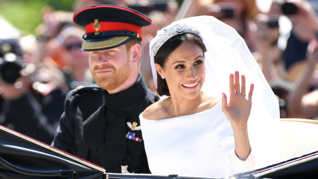 WINDSOR, ENGLAND - MAY 19:  (L-R) Prince Harry, Duke of Sussex and Meghan, Duchess of Sussex leave Windsor Castle in the Ascot Landau carriage during a procession after getting married at St Georges Chapel on May 19, 2018 in Windsor, England. Prince Henry Charles Albert David of Wales marries Ms. Meghan Markle in a service at St George's Chapel inside the grounds of Windsor Castle. Among the guests were 2200 members of the public, the royal family and Ms. Markle's mother, Doria Ragland.  (Photo by Karwai Tang/WireImage)