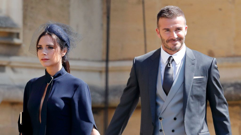 WINDSOR, UNITED KINGDOM - MAY 19: (EMBARGOED FOR PUBLICATION IN UK NEWSPAPERS UNTIL 24 HOURS AFTER CREATE DATE AND TIME) Victoria Beckham and David Beckham attend the wedding of Prince Harry to Ms Meghan Markle at St George's Chapel, Windsor Castle on May 19, 2018 in Windsor, England. Prince Henry Charles Albert David of Wales marries Ms. Meghan Markle in a service at St George's Chapel inside the grounds of Windsor Castle. Among the guests were 2200 members of the public, the royal family and Ms. Markle's Mother Doria Ragland. (Photo by Max Mumby/Indigo/Getty Images)
