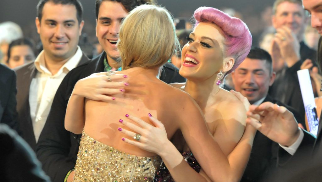 LOS ANGELES, CA - NOVEMBER 20:  Singer Taylor Swift (L) and Katy Perry at the 2011 American Music Awards held at Nokia Theatre L.A. LIVE on November 20, 2011 in Los Angeles, California.  (Photo by Lester Cohen/AMA2011/WireImage)