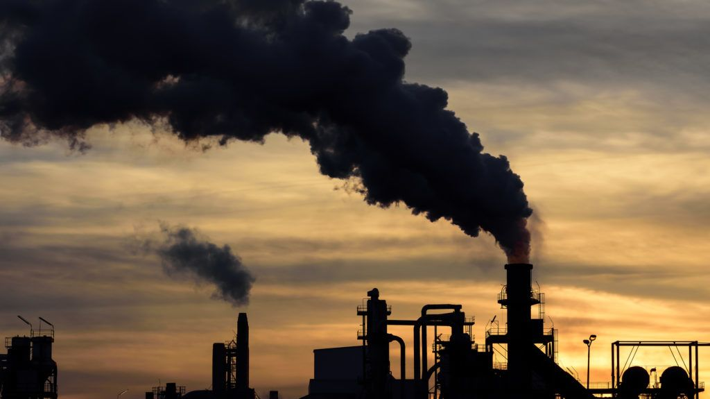 a cloud of pollution released by an industry.