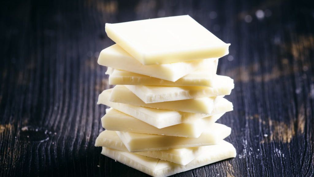 Delicious white chocolate, low key, selective focus
