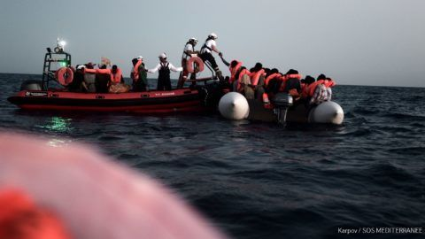 """A handout picture taken in the search and rescue zone in the Mediterranean sea on June 9, 2018 and released on June 11, 2018 by SOS Mediterranee NGO shows migrants being rescued before boarding the French NGO's ship Aquarius. The EU on June 11, 2018 called on Italy and Malta to reach a """"swift resolution"""" to allow the Aquarius, a search and rescue ship run in partnership between """"SOS Mediterranee"""" and Doctors without borders (MSF), carrying hundreds of migrants to dock, saying it was a """"humanitarian imperative"""". Some 629 people, including pregnant women and scores of children, were saved by SOS Mediterranean on JUne 9 and are stuck aboard the French NGO's ship Aquarius, which is currently between Malta and Sicily waiting for a secure port. / AFP PHOTO / SOS MEDITERRANEE / Karpov / RESTRICTED TO EDITORIAL USE - MANDATORY CREDIT """"AFP PHOTO / KARPOV / SOS MEDITERRANEE"""" - NO MARKETING NO ADVERTISING CAMPAIGNS - DISTRIBUTED AS A SERVICE TO CLIENTS"""