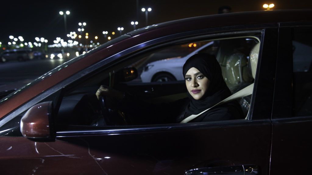 Saudi woman Sabika Habib drives her car through the streets of Khobar City on her way to Kingdom of Bahrain. For the first time little after midnight the law allow women to drive on June 24, 2018. Saudi Arabia will allow women to drive from June 24, ending the world's only ban on female motorists, a historic reform marred by what rights groups call an expanding crackdown on activists. The move, which follows a sweeping crackdown on women activists who long opposed the ban, is part of Crown Prince Mohammed bin Salman's wide-ranging reform drive to modernise the conservative petrostate.   / AFP PHOTO / HUSSAIN RADWAN
