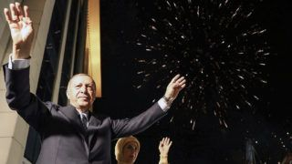 """This handout picture released on June 25, 2018 shows Turkish President Tayyip Erdogan and his wife Emine Erdogan greeting supporters gathered above a balcony at the headquarters of the AK Party in Ankara, on June 24, 2018 as they celebrate Erdogan winning five more years in office with sweeping new powers after a decisive election victory.A night of triumph for Erdogan saw the man who has dominated Turkey for the last 15 years declared winner of presidential poll without needing a second round and lead his ruling party-led alliance to an overall majority in parliament, as his main rival accepted the outcome despite bitter complaints over the conduct of the campaign. / AFP PHOTO / TURKISH PRESIDENTIAL PRESS SERVICE AND AFP PHOTO / KAYHAN OZER / RESTRICTED TO EDITORIAL USE - MANDATORY CREDIT """"AFP PHOTO / TURKISH PRESIDENTIAL PRESS  SERVICE / KAYHAN OZER"""" - NO MARKETING NO ADVERTISING CAMPAIGNS - DISTRIBUTED AS A SERVICE TO CLIENTS"""