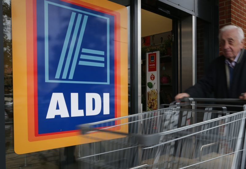 A man pushes a shoppping trolley as he arrives at an Aldi supermarket store in London on September 26, 2016. Aldi UK announced on Monday that it will invest £300 million ($389 million, 346 million euros) to revamp its stores over the next three years. Aldi and its German rival Lidl have boomed in Britain, grabbing market share from traditional supermarkets Asda, Morrison, Sainsbury's and Tesco, as customers tightened their belts to save cash. / AFP PHOTO / Daniel Leal-Olivas
