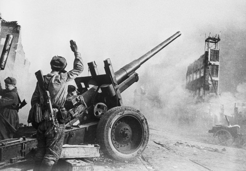 A Soviet gun crew keeping up fire in the streets of Danzig, Germany. World War Two. Photo reproduction.
