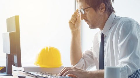 Architect working in office.