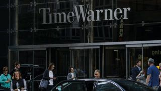 NEW YORK, NY - JUNE 12: People walk past the Time Warner Center, June 12, 2018 in New York City. A federal judge today said that AT&T can move forward with its $85 billion acquisition of Time Warner, which the U.S. Justice Department had sought to block.   Drew Angerer/Getty Images/AFP