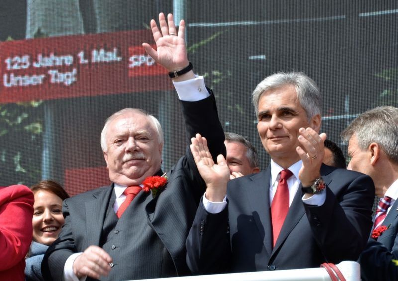 VIENNA, AUSTRIA - MAY 01: Chancellor of Austria Werner Faymann (R) and Mayor of Vienna Michael Haupl (L) seen as thousands of people take part in a rally to mark May Day, International Workers' Day, held by Social Democratic Party of Austria in Vienna, Austria on May 01, 2015. Hasan Tosun / Anadolu Agency