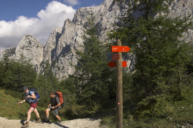 Hikers on hiking track, Vrsic Pass, Soca Valley, Triglav National Park, Julian Alps, Slovenia, Europe