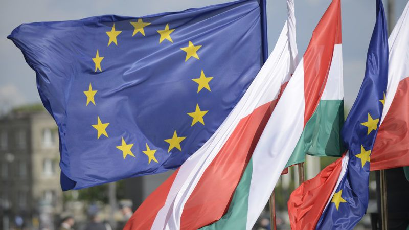 An EU flag is seen wavering in the wind amongst Polish and Hungarian flags in Warsaw, Poland on May 14, 2018 ahead of Hungarian PM Viktor Orban's visit to the Tomb of the Unknown Soldier. (Photo by Jaap Arriens/NurPhoto)