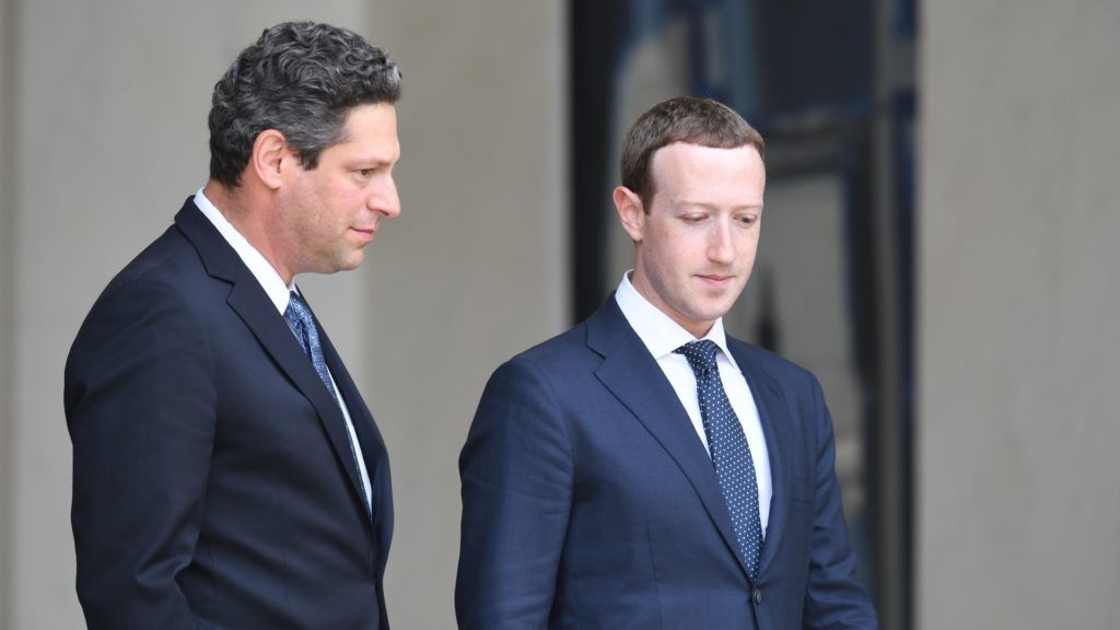 "Facebook's CEO Mark Zuckerberg (R), flanked by Facebook's vice president of global public policy Joel Kaplan (R), leaves the Elysee presidential palace, in Paris, on May 23, 2018 following a meeting with French President on the day of the ""Tech for Good"" summit. / AFP PHOTO / Alain JOCARD"