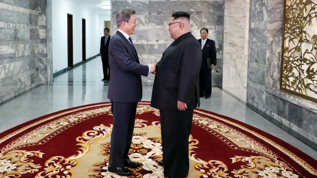 This picture taken on May 26, 2018 and released by the Blue House via Dong-A Ilbo shows South Korea's President Moon Jae-in (L) shaking hands with North Korea's leader Kim Jong Un before their second summit at the north side of the truce village of Panmunjom in the Demilitarized Zone (DMZ). South Korea said President Moon Jae-in met with North Korea's leader Kim Jong Un on May 26 inside the Demilitarised Zone dividing the two nations, a day after US President Donald Trump threatened to abandon a summit with Pyongyang. / AFP PHOTO / Dong-A Ilbo / Handout / South Korea OUT