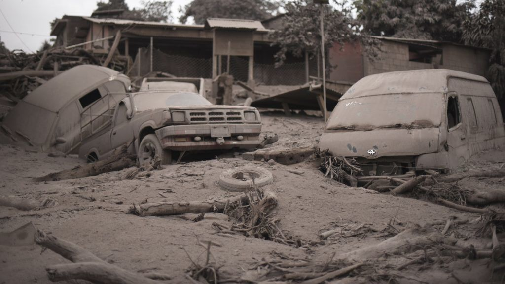 View of the damage casued by the eruption of the Fuego Volcano in San Miguel Los Lotes, a village in Escuintla Department, about 35 km southwest of Guatemala City, on June 4, 2018. At least 25 people were killed, according to the National Coordinator for Disaster Reduction (Conred), when Guatemala's Fuego volcano erupted Sunday, belching ash and rock and forcing the airport to close.. / AFP PHOTO / Johan ORDONEZ