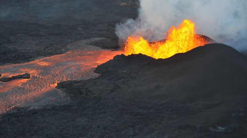 """This image obtained June 5, 2018, from the US Geological Survey (USGS) shows an aerial view of lava fountains continuing at fissure 8, although overnight USGS field crews reported reduced fountain heights. The lava fountain has built a 35 m (115 ft) high spatter cone, as wells as an actively-growing spatter rampart on its eastern side. / AFP PHOTO / US Geological Survey / HO / RESTRICTED TO EDITORIAL USE - MANDATORY CREDIT """"AFP PHOTO / US Geological Survey/HO"""" - NO MARKETING NO ADVERTISING CAMPAIGNS - DISTRIBUTED AS A SERVICE TO CLIENTS"""