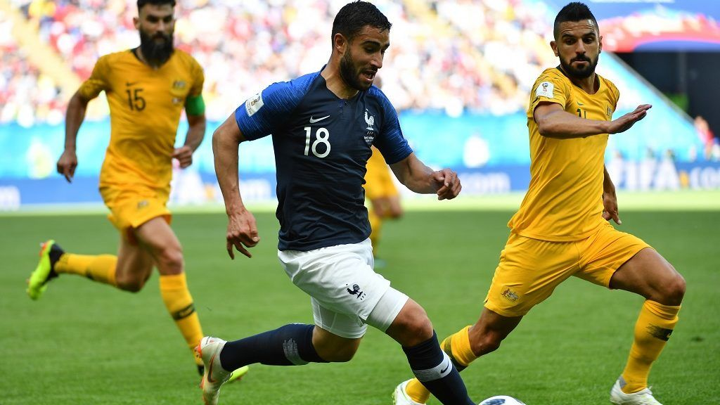 France's midfielder Nabil Fekir (C) vies with Australia's defender Aziz Behich during the Russia 2018 World Cup Group C football match between France and Australia at the Kazan Arena in Kazan on June 16, 2018. / AFP PHOTO / SAEED KHAN / RESTRICTED TO EDITORIAL USE - NO MOBILE PUSH ALERTS/DOWNLOADS