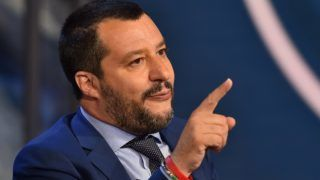 "Italy's Interior Minister and Deputy Prime Minister Matteo Salvini gestures as he speaks during the Italian talk show ""Porta a Porta"", broadcast on Italian channel Rai 1, in Rome, on June 20, 2018. / AFP PHOTO / Andreas SOLARO"