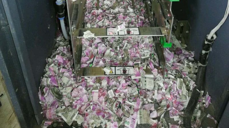 This picture taken on June 19, 2018, shows shredded Indian currency notes in 2000 and 500 rupee denominations after being eaten by rats in at ATM in Tinsukia in India's northeastern Assam state.  Indian police on June 21 said rats nibbled through more than a million rupees of banknotes after busting into a cash machine in the country's northeast. / AFP PHOTO / -