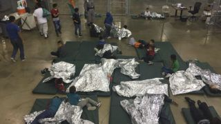 """(FILES) In this file US Customs and Border Protection photo dated June 17, 2018 and obtained June 18, 2018 shows intake of illegal border crossers by US Border Patrol agents at the Central Processing Center in McAllen, Texas. A US judge ordered that migrant families separated at the border with Mexico under President Donald Trump's """"zero tolerance"""" policy be reunited within 30 days. For children under five the reunification must take place within two weeks of the order, issued June 26, 2018 by US District Judge Dana Sabraw in San Diego. / AFP PHOTO / US Customs and Border Protection / Handout / RESTRICTED TO EDITORIAL USE - MANDATORY CREDIT """"AFP PHOTO / US CUSTOMS AND BORDER PROTECTION/HANDOUT"""" - NO MARKETING NO ADVERTISING CAMPAIGNS - DISTRIBUTED AS A SERVICE TO CLIENTS"""