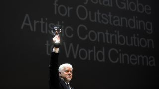 US film actor and film producer Tim Robbins reacts after receiving the Crystal Globe Award for the Outstanding Artistic Contribution to the World of Cinema at the start of the Karlovy Vary International Film Festival (KVIFF) in Karlovy Vary on June 29, 2018.  / AFP PHOTO / Michal CIZEK