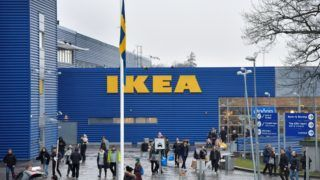A Swedish flag flies at half mast outside an IKEA store in Stockholm, on January 28, 2018.  Ingvar Kamprad, the enigmatic founder of Swedish furniture giant IKEA, died aged 91 on Sunday, the company said. / AFP PHOTO / TT News Agency / Anders WIKLUND / Sweden OUT