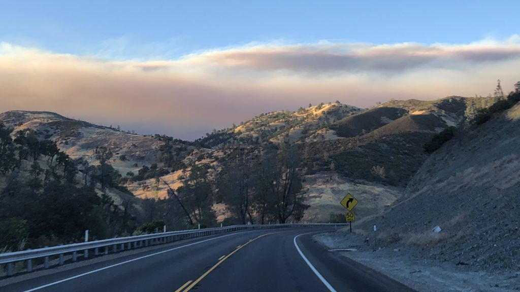 Smoke rises from Pawnee Fire as seen from Highway 20 in Lake County, northern California on June 25, 2018. Wind-driven wildfires destroyed buildings and threatened hundreds of others as they raced across dry brush in rural Northern California. The Pawnee Fire, which broke out on June 23 near the community of Clearlake Oaks, has destroyed 12 buildings and threatened an additional 600. Authorities ordered people to evacuate all homes in the Spring Valley area, where about 3,000 people live.