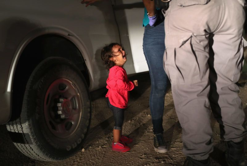 """MCALLEN, TX - JUNE 12: A two-year-old Honduran asylum seeker cries as her mother is searched and detained near the U.S.-Mexico border on June 12, 2018 in McAllen, Texas. The asylum seekers had rafted across the Rio Grande from Mexico and were detained by U.S. Border Patrol agents before being sent to a processing center for possible separation. Customs and Border Protection (CBP) is executing the Trump administration's """"zero tolerance"""" policy towards undocumented immigrants. U.S. Attorney General Jeff Sessions also said that domestic and gang violence in immigrants' country of origin would no longer qualify them for political asylum status.   John Moore/Getty Images/AFP"""