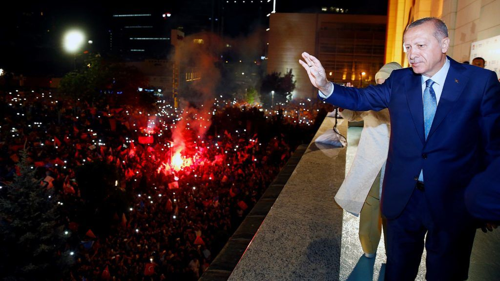 ANKARA, TURKEY - JUNE 25: President of Turkey and leader of the Justice and Development Party (AK Party) Recep Tayyip Erdogan (R) greets the crowd from the balcony of the ruling AK Party's headquarters following his election success in presidential and parliamentary elections in Ankara, Turkey on June 25, 2018. Kayhan Ozer / Anadolu Agency