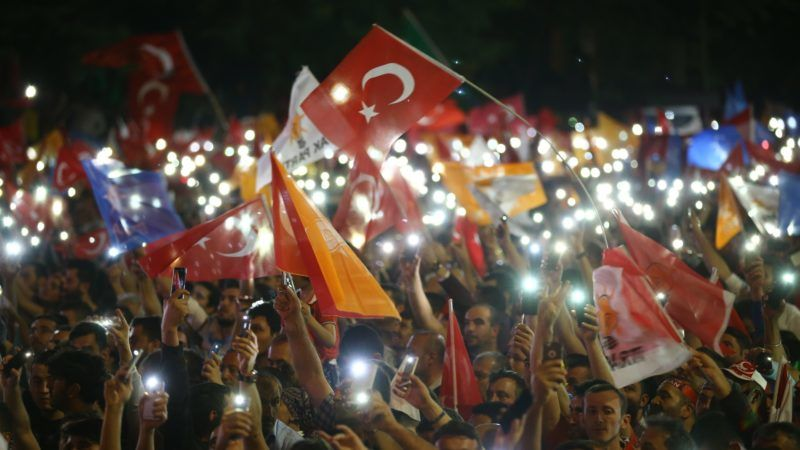 ANKARA, TURKEY - JUNE 25: People wave Turkish flags and hold lit mobile phones as they gather for President of Turkey and leader of the Justice and Development Party (AK Party) Recep Tayyip Erdogan's speech from the balcony of the ruling AK Party's headquarters following his election success in presidential and parliamentary elections in Ankara, Turkey on June 25, 2018. Mustafa Kamaci / Anadolu Agency