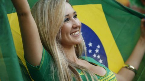 A supporter of Brazil cheirs their team during the 2014 FIFA World Cup Brazil Group A football match between Brazil and Croatia at Arena de Sao Paulo on June 12, 2014 in Sao Paulo, Brazil.