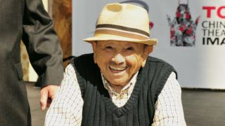"""HOLLYWOOD, CA - SEPTEMBER 18:  """"The Lollipop Kid"""" actor Jerry Maren, 93, Last Of The """"Munchkins"""" from """"The Wizard Of Oz"""" attends the Handprint-Footprint Ceremony at the TCL Chinese Theatre on September 18, 2013 in Hollywood, California.  (Photo by John M. Heller/FilmMagic)"""