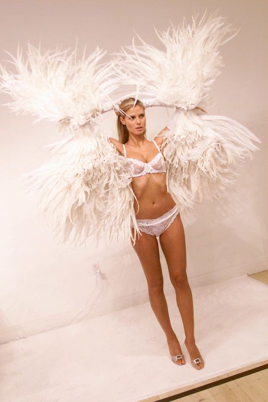 Victoria's Secret model fittings, in preparations for the Victoria's Secret 2001 Fashion Show (scheduled for Tuesday Nov. 13.) Pictured: Model Heidi Klum trying out her wings. New York City 11/12/2001.Photo: Evan Agostini/ImageDirect.  ***Exclusive***