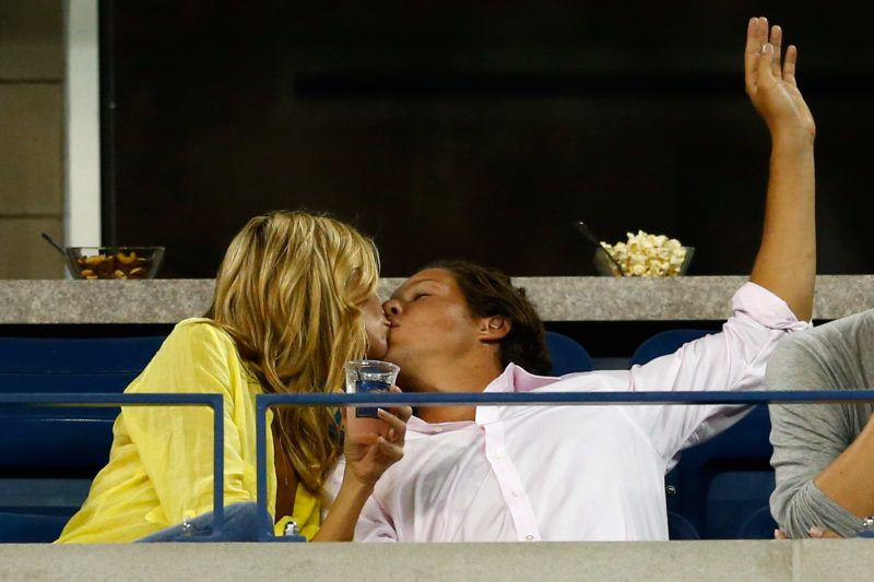 NEW YORK, NY - SEPTEMBER 01:  Vito Schnabel kisses Heidi Klum as Victoria Azarenka of Belarus plays Aleksandra Krunic of Serbia on Day Eight of the 2014 US Open at the USTA Billie Jean King National Tennis Center on September 1, 2014 in the Flushing neighborhood of the Queens borough of New York City.  (Photo by Julian Finney/Getty Images)