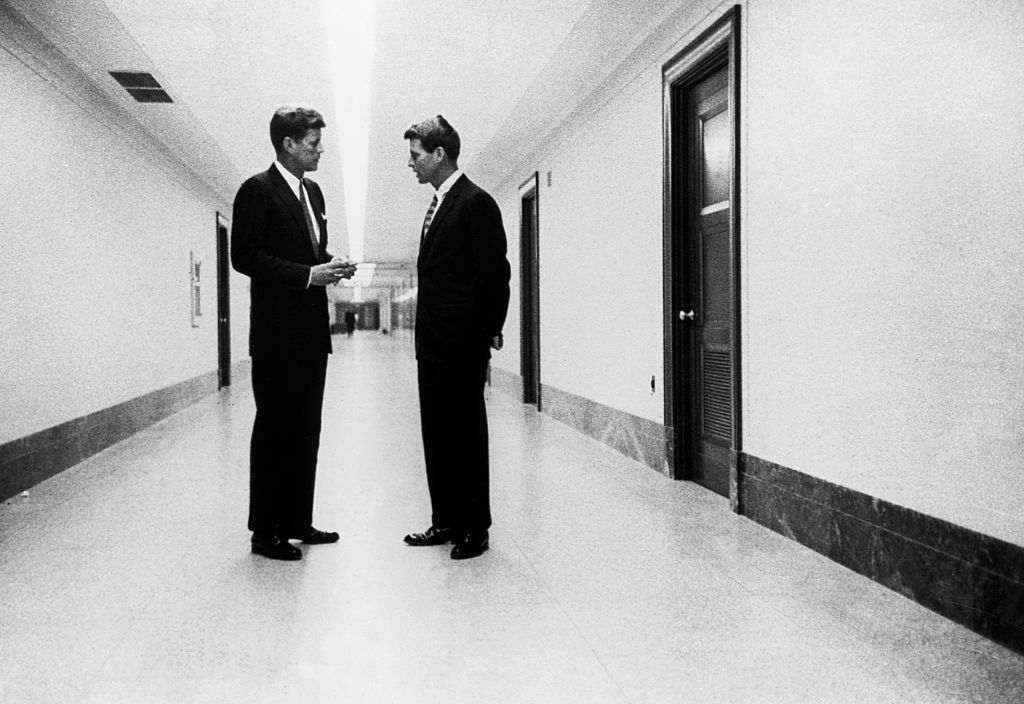 Senator John F. Kennedy and brother Robert F. Kennedy conferring in a hallway, August 4, 1959. (Photo by © CORBIS/Corbis via Getty Images)