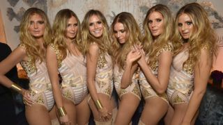 NEW YORK, NY - OCTOBER 31:  Model Heidi Klum (3rd L) reveals her costume during Heidi Klum's 17th Annual Halloween Party sponsored by SVEDKA Vodka at Vandal on October 31, 2016 in New York City.  (Photo by Mike Coppola/Getty Images for Heidi Klum)