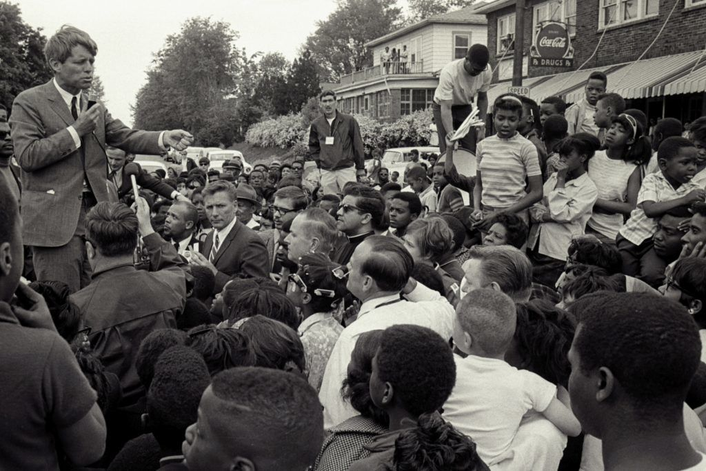 American senator Robert F. Kennedy (1925 - 1968) talks with supporters as he campaigns for the democratic Presidential nomination in Indiana, early May 1968. (Photo by  Andrew Sacks/Getty Images)