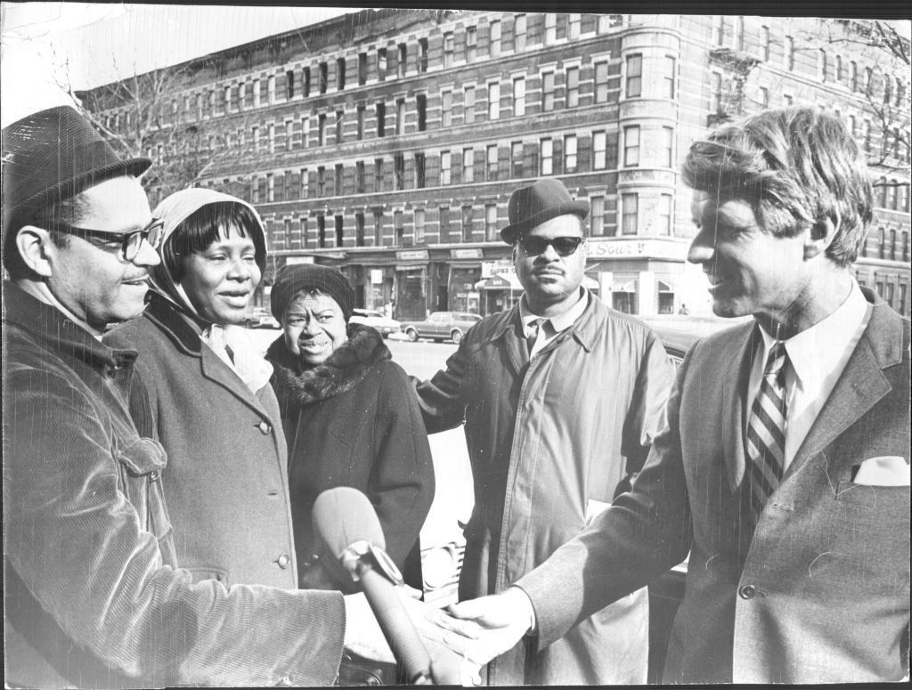Senator Robert F. Kennedy signs autographs and shakes hands with residents of Harlem at 138th Street and 7th Avenue. He had just finished a luncheon meeting with Harlem business and civic leaders at the Red Rooster Restaurant. February 07, 1968. (Photo by Richard Gummere/New York Post Archives /(c) NYP Holdings, Inc. via Getty Images)